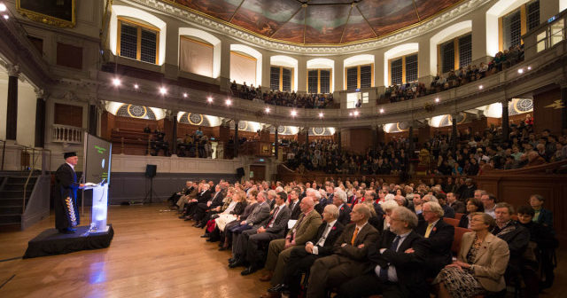 This image shows an audience listening to a talk inside the Sheldonian Theatre