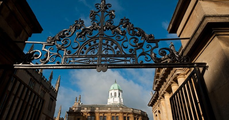 Image of the gates looking into the quad by the Sheldonian Theatre (c) John Cairns