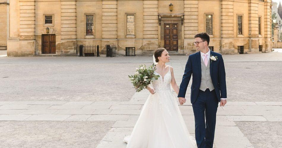 Bride and groom outside Sheldonian Theatre, wedding venue, Oxford