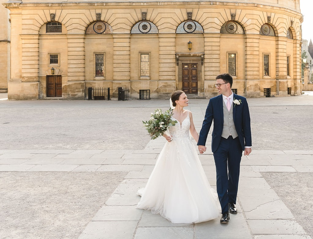 Bride and groom outside Sheldonian Theatre, wedding venue, Oxford