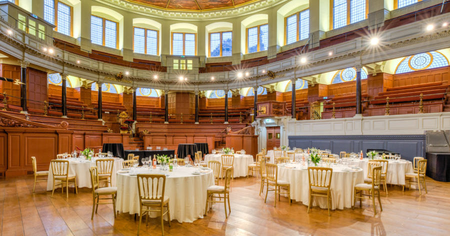 This is an image of the Sheldonian Theatre set up for a dinner