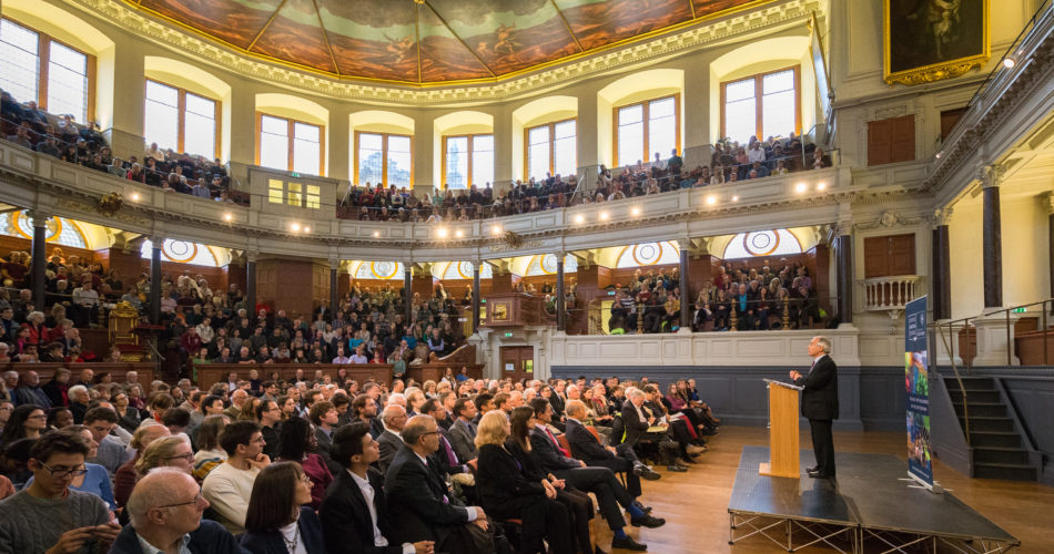 Guests listening to a talk at the Sheldonian Theatre