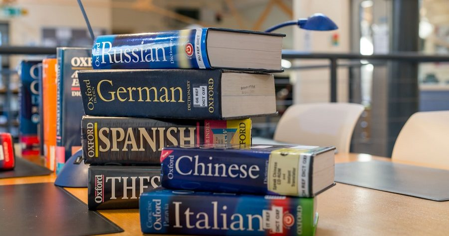 A pile of language books on display at the Language Centre