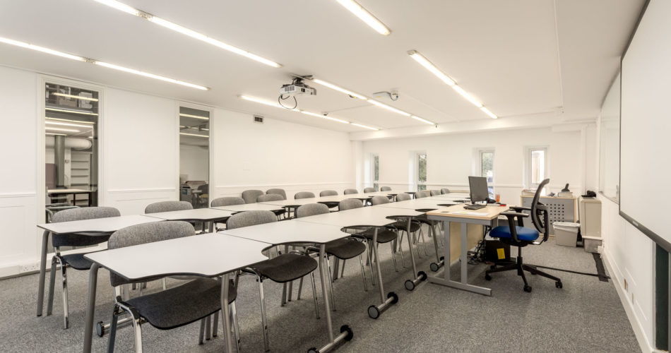 This is an image of rows of chairs and tables in a meeting room at the Language Centre